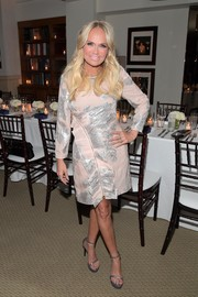 Kristin Chenoweth complemented her dress with silver platform sandals by Stuart Weitzman.