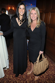 There's nothing like a dark solid-colored maxi dress to make one look long and streamlined. Lisa Ling picked a black V-Neck number when she attended the Girard-Perregaux and Asia Society event.