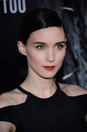 Rooney Mara wore a rich red lipstick to brighten her edgy dark gown and raven tresses at the NYC premiere of 'The Girl With the Dragon Tattoo.'