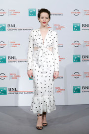 Claire Foy looked fab in a dotted white cutout dress by Carolina Herrera at the Rome Film Fest photocall for 'The Girl in the Spider's Web.'