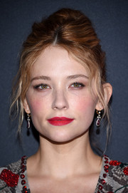 Haley Bennett swiped on some scarlet lipstick for a bright pop to her beauty look.