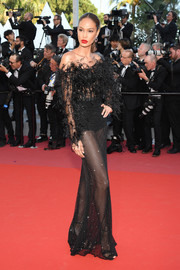 Joan Smals looked sultry-glam in a sheer black off-the-shoulder gown by Roberto Cavalli Couture at the Cannes Film Festival screening of 'Girls of the Sun.'