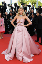 Elsa Hosk turned heads in a strapless pink cutout gown with a voluminous overskirt at the Cannes Film Festival screening of 'Girls of the Sun.'
