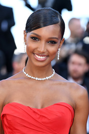Jasmine Tookes looked elegant with her slicked-down ponytail at the Cannes Film Festival screening of 'Girls of the Sun.'
