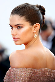 Sara Sampaio pulled her tresses back into a twisted bun for the Cannes Film Festival screening of 'Girls of the Sun.'