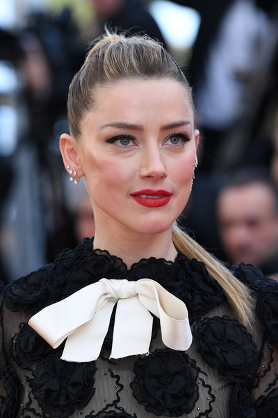 Amber Heard wore her hair in an edgy ponytail at the Cannes Film Festival screening of 'Girls of the Sun.'