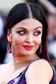 Aishwarya Rai wore her hair in a straight style with a center part at the Cannes Film Festival screening of 'Girls of the Sun.'