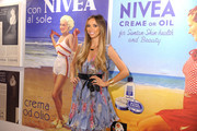 Giuliana Rancic, NIVEA?s Birthday Ambassador, gets an interactive look at NIVEA?s 100-year-old history at the Turntable Journey Through the Years Station at Grand Central Station on July 25, 2011 in New York City.