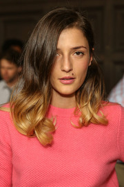 Eleonora Carisi's lipstick was a perfect match to her sweater.