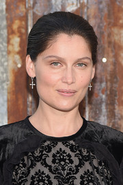 Laetitia Casta sported a short, slicked-back hairstyle at the Givenchy Spring 2016 show.