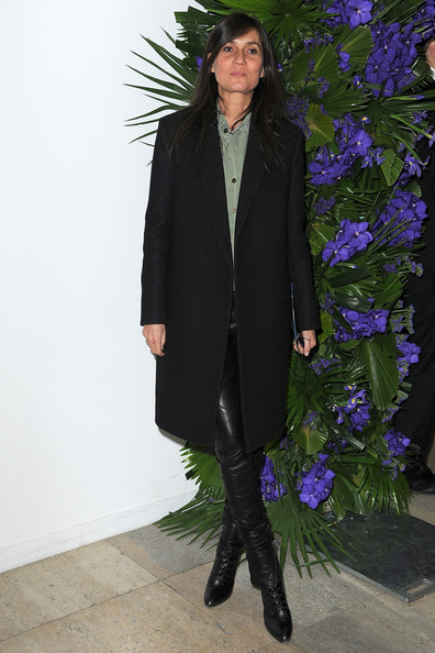 Emmanuelle Alt paired her sleek leather pants with matching lace up boots.