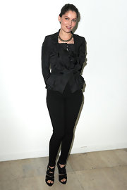 Laetitia dons a ruffled black taffeta jacket with her sleek black pants for the Givenchy fashion show in Paris.