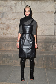 Ulyana Sergeenko rocked a leather-on-leather over-the-knee boots and dress combo at the Givenchy fashion show.