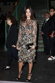 Julia Restoin-Roitfeld showed a bit of skin in a Givenchy monochrome print dress with a see-through bodice during the label's fashion show.