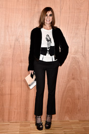 Carine Roitfeld teamed her tee with a pair of cropped slacks.