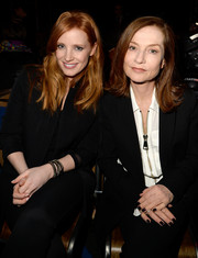 Jessica Chastain accessorized with a trio of chain bangles at the Givenchy fashion show.