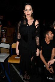Katy Perry showed her goth side with this black lace tie-neck blouse and tank top combo at the Givenchy fashion show.