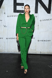 Maria Sharapova attended the Givenchy Spring 2020 show wearing a stylish green pantsuit from the label.