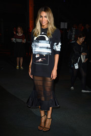 Ciara chose a sophisticated sheer black skirt for the Givenchy fashion show, but it looked a little odd paired with that sweater.