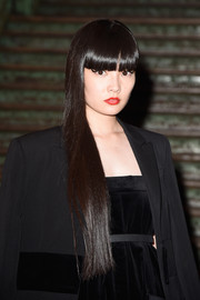 Kozue Akimoto looked dramatic at the Givenchy show with her ultra-long locks and stark bangs.