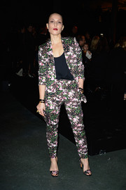 Noomi Rapace looked smart in a floral pantsuit when she attended the Givenchy fashion show.