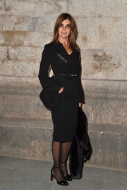 Carine Roitfeld paired a fitted zip-embellished jacket with a pencil skirt for the Givenchy fashion show.