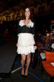 Julia Restoin-Roitfeld looked very frilly at the Givenchy fashion show in a black-and-white dress with a corset bodice and a tiered lace skirt.