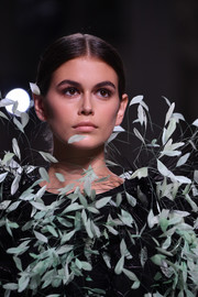 Kaia Gerber walked the Givenchy Couture runway wearing a classic center-parted updo.