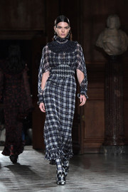 Kendall Jenner walked the Givenchy runway wearing a floaty plaid dress.
