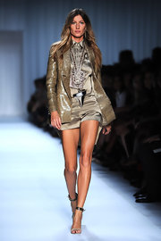 Gisele Bundchen looked haute on the Givenchy runway in olive green shorts paired with metallic strappy sandals.