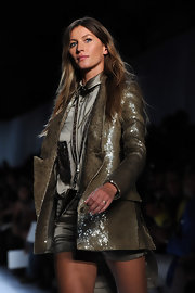 On the Givenchy runway in Paris, Gisele rocked a shiny olive green blazer.
