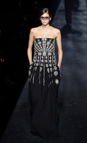 Kaia Gerber showed off an opulently embellished strapless gown on the Givenchy runway.