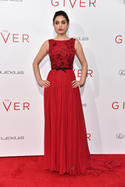 Odeya Rush went all out with the glamour at the NYC premiere of 'The Giver,' wearing this crimson Georges Hobeika Couture gown featuring an embellished bodice and a floor-sweeping train.