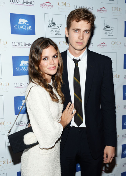 Rachel Bilson accessorized with a lovely black Chanel chain-strap bag adorned with a white flower during the Glacier Films launch party.