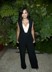 Ayesha Curry attended the Glad to Waste Less event wearing a plunging black jumpsuit over a cream-colored corset.