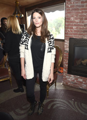 Ashley Greene attended the Glam App's Glamchella dressed down in a patterned cardigan and skinny jeans.