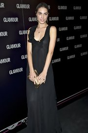 Amber Le Bon held a gold clutch at the 2011 Glamour Magazine Beauty Awards.