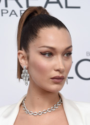 Bella Hadid glammed it up with a pair of statement diamond earrings by Bulgari.