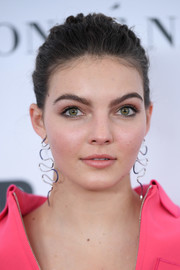 Camren Bicondova swept her hair back into a casual bun for the 2017 Glamour Women of the Year Awards.