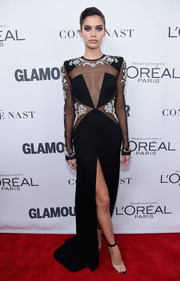 Sara Sampaio coordinated her dress with a pair of Manolo Blahnik PVC sandals.