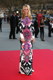 Poppy Delevingne caught attention in a brightly printed  Emilio Pucci dress at the preview of The Glamour of Italian Fashion exhibition in London.