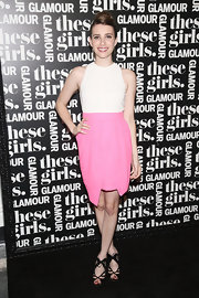 Emma Roberts' black evening sandals were a sexy complement to her sweet dress during Glamour's presentation of 'These Girls.'