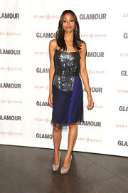 Zoe Saldana dazzled at the 'Glamour' soiree in LA. She paired her glamorous cocktail dress with taupe platform pumps.