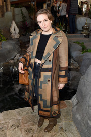 Lena Dunham attended Glamour's Women Rewriting Hollywood lunch wearing an oversized geometric-print wool coat.