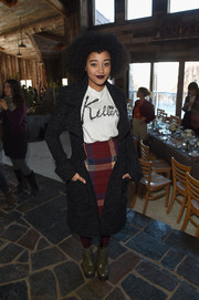 Amandla Stenberg teamed a chic charcoal coat with a T-shirt and a plaid skirt for Glamour's Women Rewriting Hollywood lunch.