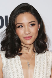 For her lips, Constance Wu chose a soft pink hue.