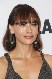 Rashida Jones sported a bob with eye-grazing bangs and a prominent undercurl during the Glamour Women of the Year 2016.