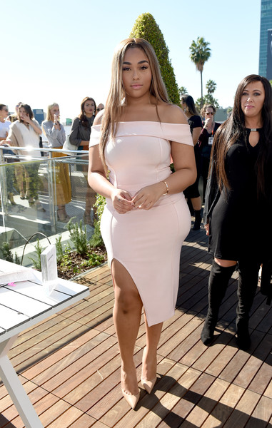 Jordyn Woods paired her frock with simple beige pumps.