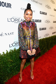 A black leather clutch with gold trim finished off Yara Shahidi's attire.