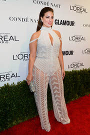Ashley Graham paired her sultry outfit with a bejeweled clutch.